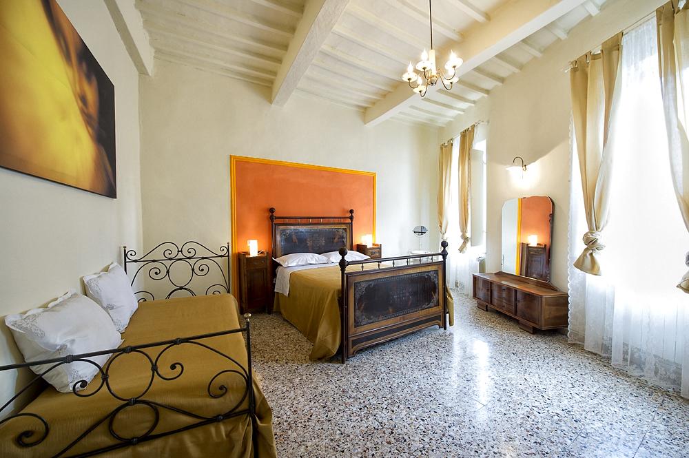 camera gialla - Casa Vacanze Fatucchi
